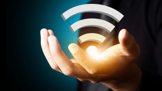 Logotipo de WiFi en una mano
